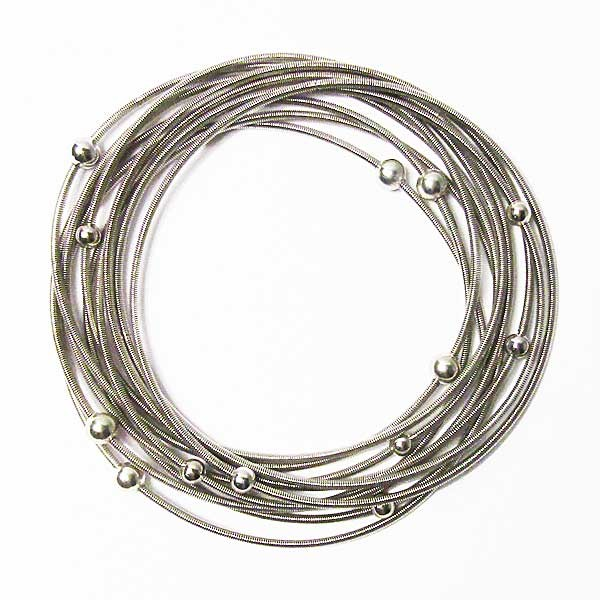 Stunning Handcrafted Stack of Silver Beads Silver Piano Wire Bracelet